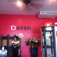 Photo taken at Delish Cafe by Ekaterina P. on 3/8/2012