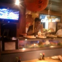 Photo taken at Hook's Sushi Bar & Thai Food by Katherine G. on 3/16/2012