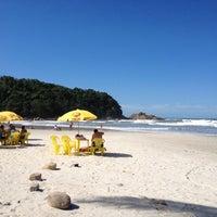 Photo taken at Praia Grande by Kelly N. on 5/20/2012