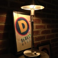 Photo taken at Dewey's Pizza by Helen S. on 7/8/2012
