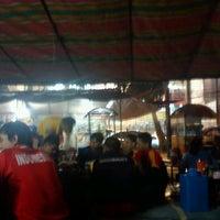 Photo taken at Angkringan Nasi Kucing Mas Jojo by Vivi A. on 4/20/2012