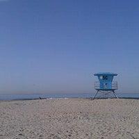 Photo taken at Coronado Beach by Melani G. on 4/7/2012