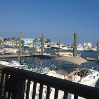Photo taken at Dockside Restaurant & Bar by Joe R. on 8/31/2012