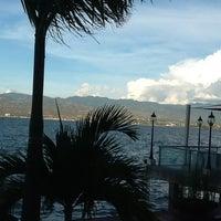 Photo taken at Pantai Talise by Titin T. on 5/3/2012