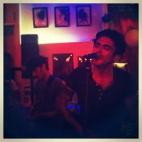 Photo taken at Indie Rock Café by Marcelo S. on 7/13/2012