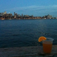 Photo taken at East River Esplanade by Kristen D. on 7/30/2012