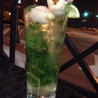 Photo taken at Moshi Sushi Bar by Christina K. on 3/23/2012