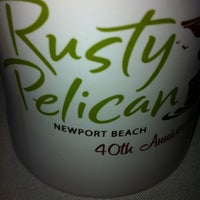 Photo taken at The Rusty Pelican by Stephanie C. on 7/8/2012