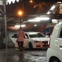 Photo taken at Car Wash Kampung Baru by Sam K. on 7/28/2012