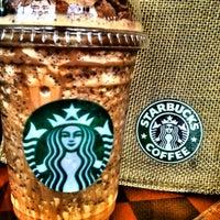 Photo taken at Starbucks by Jom J. on 5/2/2012