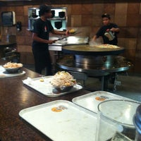 Photo taken at YC'S Mongolian Grill by Rebecca S. on 6/27/2012