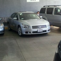 Photo taken at Woodland Hills Nissan by Sebastien S. on 2/24/2012
