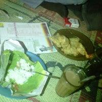 Photo taken at Angkringan Kopi Joss Mbak Ita by eka p. on 5/12/2012