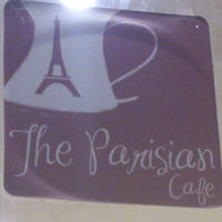 Photo taken at The Parisian Cafe by Khaled H. on 7/5/2012