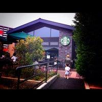 Photo taken at Starbucks by Satoshi Y. on 6/2/2012