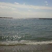 Photo taken at Bassamarea Beach & Sail by Pozzi S. on 8/31/2012