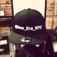 Photo taken at New Era Flagship Store: New York by Menel F. on 3/31/2012