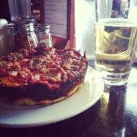 Photo taken at Pequod's Pizzeria by Ruben M. on 4/13/2012