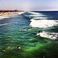 Photo taken at Huntington Beach Pier by Rudy R. on 7/27/2012