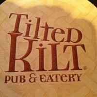 Photo taken at Tilted Kilt Pub & Eatery by Scott D. on 5/4/2012