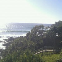 Photo taken at Cabarita Beach by Theo C. on 4/8/2012