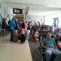Photo taken at Gate A72 by Ian A. on 6/7/2012