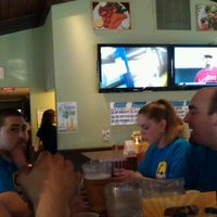 Photo taken at MicGinny's Restaurant & Sports Pub by MJ B. on 6/15/2012