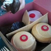 Photo taken at Sprinkles Cupcakes by Erika B. on 7/24/2012