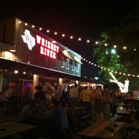 Photo taken at Whiskey River Dancehall & Saloon by Adam S. on 5/27/2012