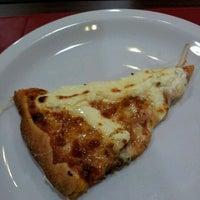 Photo taken at Super Pizza Pan by Carolina N. on 4/20/2012