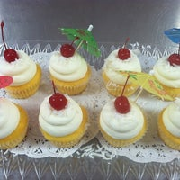Photo taken at Petite Cupcakes and Events by Petite C. on 6/21/2012