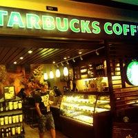 Photo taken at Starbucks by Gustavo G. on 3/16/2012