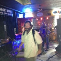 Photo taken at Trophy's Bar & Grill by A O. on 3/18/2012
