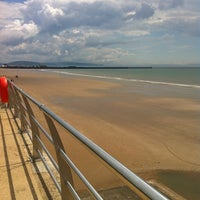 Photo taken at Swansea Bay Beach by Andrew L. on 7/8/2012