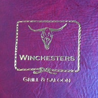 Photo taken at Winchester's Grill & Saloon by Jonathan A. on 7/26/2012