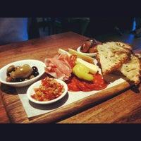 Photo taken at Novo Pizzeria & Wine Bar by KC C. on 6/24/2012