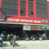Photo taken at Cycle Point Motosport Sdn Bhd Nilai by Miza L. on 6/11/2012