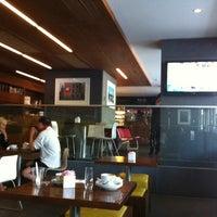 Photo taken at Giovane Café + Market + Eatery by Mk P. on 8/2/2012