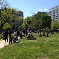 Photo taken at Farragut Square by Eric F. on 4/13/2012