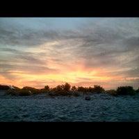 Photo taken at Easton's Beach by Sean F. on 7/5/2012