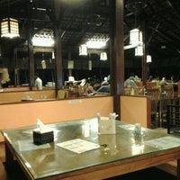Photo taken at Ikan Bakar Bambu Karimata by Trie E. on 4/7/2012