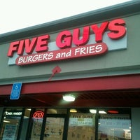 Photo taken at Five Guys by Monique M. on 2/13/2012