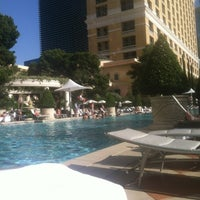 Photo taken at The Pool At Bellagio by Kevin F. on 4/28/2012