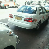 Photo taken at Taxi Stand by Jadine M. on 2/19/2012