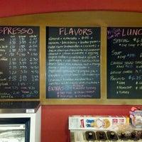 Photo taken at Jitterbug Coffeehouse by Wayne P. on 6/4/2012