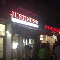 Photo taken at Justino's Pizzeria by Tina D. on 7/19/2012