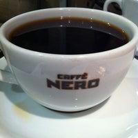 Photo taken at Caffé Nero by Mert M. on 8/29/2012