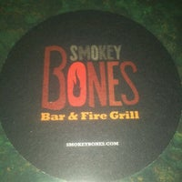 Photo taken at Smokey Bones Bar & Fire Grill by Eli S. on 7/19/2012