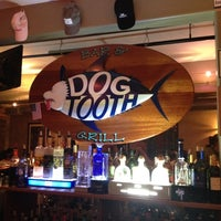 Photo taken at Dogtooth Bar & Grill by Kate C. on 8/14/2012