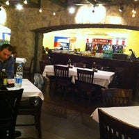 Photo taken at Romano's Macaroni Grill by Ahmed E. on 2/5/2012